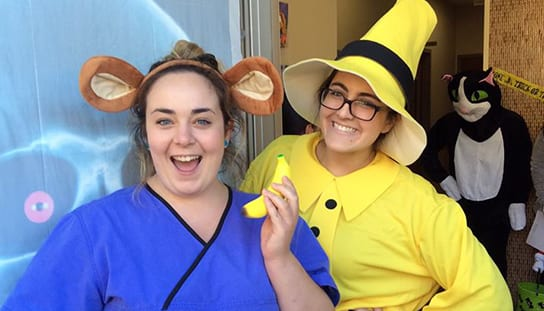 Two staff members dressed for Halloween: Veterinary Staff in Melrose